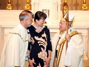Mark J. Kuhn and his wife Suzanne chat with Archbishop Chaput after Mass